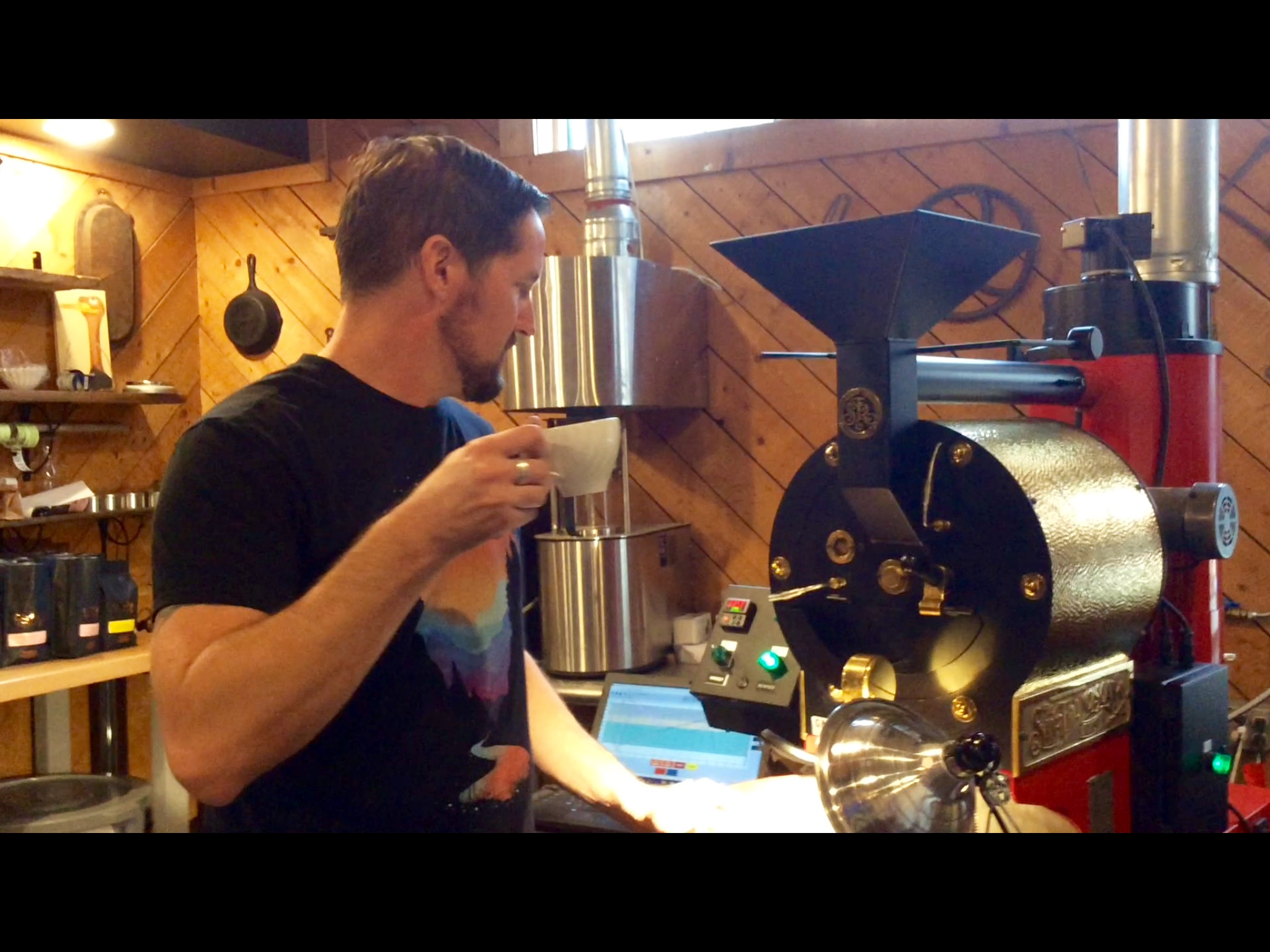 Jason Campbell enjoying a cup of freshly brewed coffee while roasting Java beans.